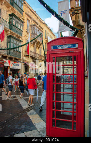 A British red phone box on a street in Valletta, Malta - Stock Photo