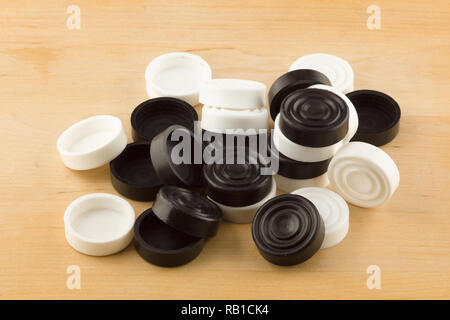 set of game checkers close-up on isolated background - Stock Photo