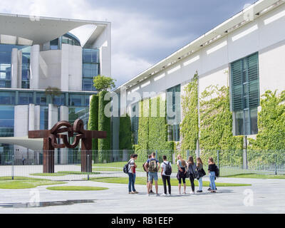 BERLIN, GERMANY - APRIL 6, 2017: Student Group In Front of Chancellor's Office Building With A Blue Cloudy Sky In Berlin - Stock Photo