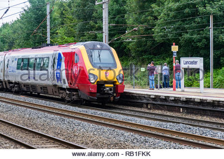 A train heading south and  operated by Virgin Trains pulls into Lancaster Railway Station, Lancashire, England, UK on the West Coast mainline - Stock Photo