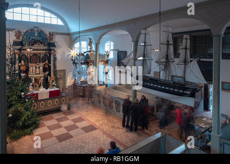 Prerow, Germany - December 30, 2018: View of the altar of the Seemannskirche in Prerow. The church dates back to the 18th century. It is the oldest ch - Stock Photo