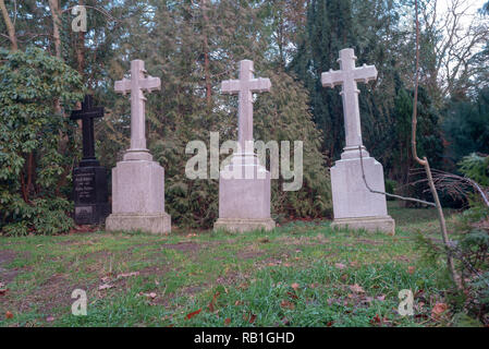 Prerow, Germany - December 30, 2018: View of three seafaring cruises on the cemetery of the Seemannskirche Prerow. It dates from the 18th century and  - Stock Photo