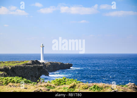 white lighthouse in cape zanpa in Japan with blue sea and sky