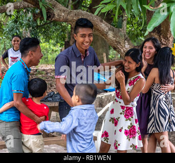 young people hugging at party in Guatemala - Stock Photo