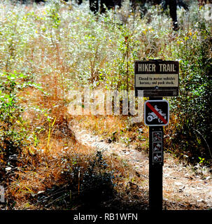 Hiker Trail sign at the Sam Houston National Forest in Texas prohibiting motor vehicles, horses, and pack stock from using the hiking trail. - Stock Photo