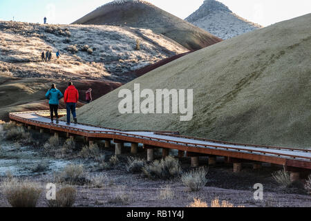 Hikers on board walk at Painted Hills at John Day Fossil - Stock Photo