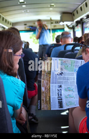 Gettysburg, PA USA. Jul 2015. Passengers reading tour guides and maps on board a tour bus at the Gettysburg National Military Park. - Stock Photo