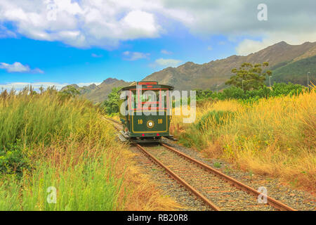 Franschhoek Wine Tram hop-on hop-off tour, one of the best ways to discover Franschhoek Valley in scenic landscape of Wine Region, near Cape Town, Sou - Stock Photo