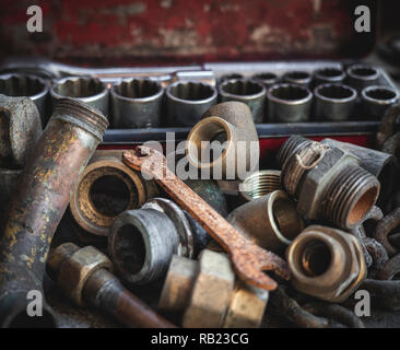Rusty old plumber pipes with rusty wrench and toolbox. Indsutrial, repair, plumbing and vintage concepts. - Stock Photo