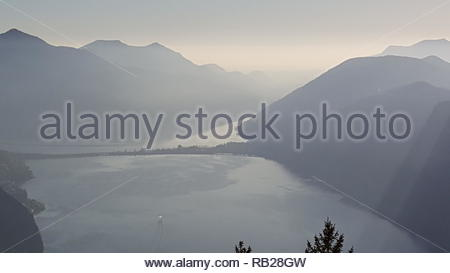 Hazy View on Lake Lugano, Switzerland - Stock Photo