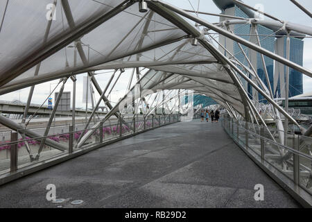 The Helix Bridge and Marina Bay Sands Hotel, Marina Bay, Singapore, Southeast Asia, Asia - Stock Photo