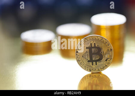 Golden Bitcoin on the flag of USA background - Stock Photo