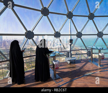 Visitors at viewing dome inside Kuwait Towers in Kuwait City, Kuwait - Stock Photo