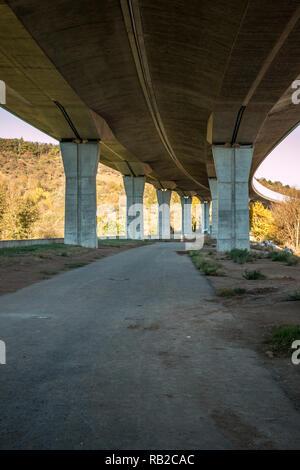 Under a big concrete bridge in Germany - Stock Photo