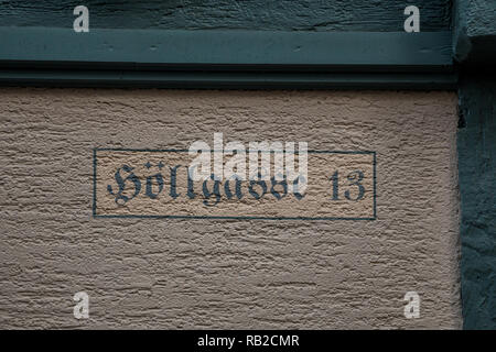 Number 13 of the house with green letters - Stock Photo