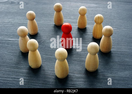 Leadership in the business team. Wooden figures on a desk. - Stock Photo