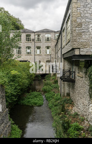 Litton Mill, a former textile factory dating from 18th century, Millers Dale, Derbyshire, UK; now converted to flats for residential use. - Stock Photo