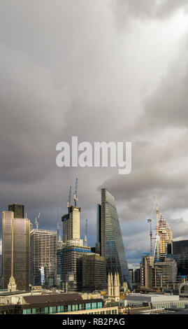 Stormy sky, City of London skyscrapers including the Cheesegrater, Tower 42 and new buildings under construction, the Scalpel and 22 & 100 Bishopsgate - Stock Photo
