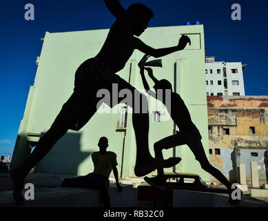 Havana, Havana, Cuba. 11th Oct, 2018. Silhouettes of young boxers seen training at the Rafael Trejo training camp in Havana, Cuba.Cuban boxers are the most successful in the history of amateur boxing, Cuba has won 32 Olympic boxing gold medals since 1972, .In 1962, professional boxing in Cuba was banned by Fidel Castro. As a consequence of Castro's ban, if fighters want to pursue their dream of becoming world champions they have to make the heartbreaking decision to defect from the country and It can be very tough for them because they are excommunicated and separated from their families. - Stock Photo