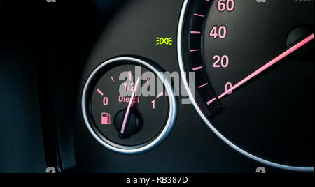 Car instrument panel. Dashboard closeup with visible speedometer and fuel level. Modern car interior details. Odometer, tachometer. Diesel engine. Car