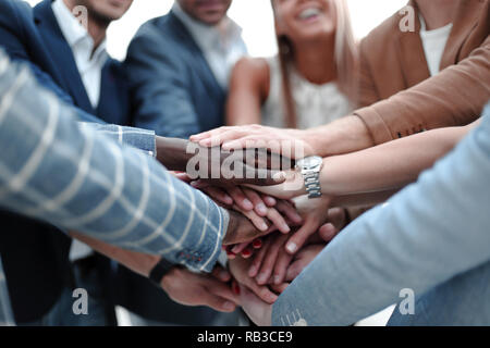 international business team shows its solidarity - Stock Photo