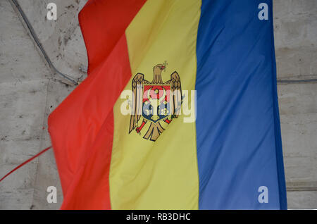 The flag of Moldova inside the Triumphal Arch (Arcul de Triumf), Cathedral Park, Chisinau (Kishinev), Republic of Moldova, November 2018 - Stock Photo