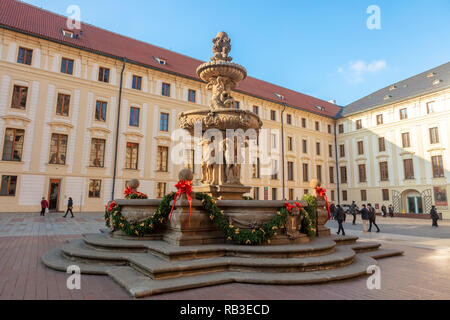 Large, richly decorated Baroque Kohls Fountain also called Lions Fountain in the second courtyard of the Prague Castle. - Stock Photo