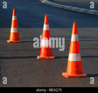 orange afety cones on asphalt - Stock Photo
