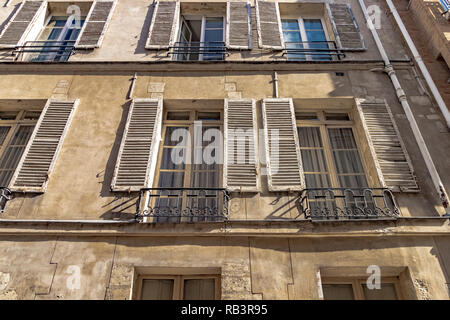 Stone building with white wooden shutters  on Rue Saint-Louis-en-l'Île,Paris ,France - Stock Photo