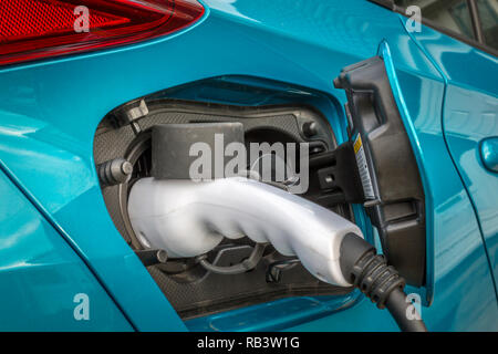 Electric car on charge - Stock Photo