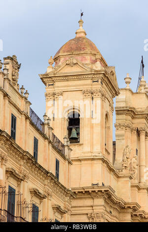 Closeup of the belltower of the historic baroque cathedral called Basilica Minore di San Nicolo in Noto, Sicily, Italy - Stock Photo