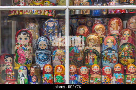 Matryoshka russian puppets lined up in shop window in Amsterdam - Stock Photo
