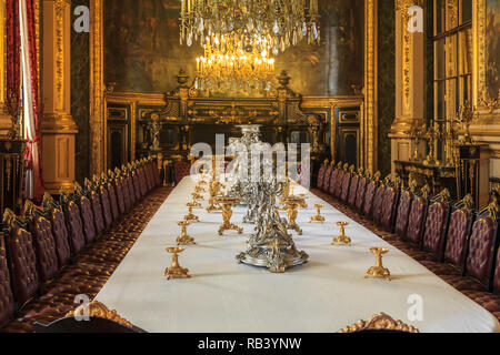 Paris, France - October 25, 2013: Banquet table in the apartments of Napoleon III in Louvre Museum with luxury baroque furnishings and stunning chande - Stock Photo