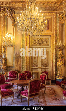 Paris, France - October 25, 2013: Interior of the apartments of Napoleon III in Louvre Museum with luxury baroque furnishings and stunning chandeliers - Stock Photo