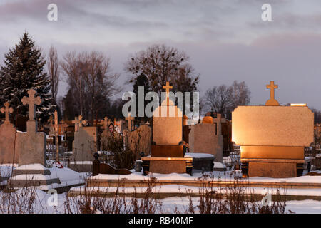 Cemetery with marble tombstone luminous on sunshine in evening time - Stock Photo