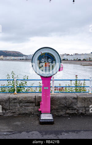 Old fashioned classic weighing machine on the pier in Llandudno Wales UK - Stock Photo