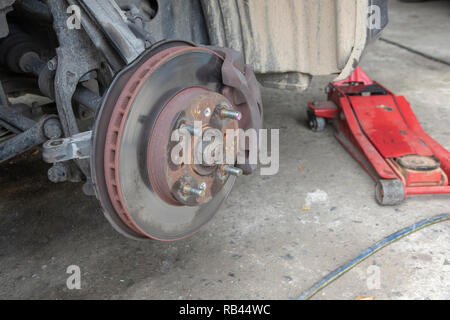 Close up detail disk break and suspension replacement on car. - Stock Photo