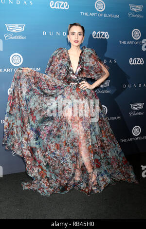 Los Angeles, California, USA. 5th Jan, 2019. LILY COLLINS at the Art of Elysium 12th Annual HEAVEN Celebration at a Private Location in Los Angeles. Credit: Kay Blake/ZUMA Wire/Alamy Live News - Stock Photo