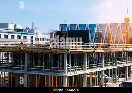 Construction crane tower on blue sky background. Crane and building working progress. Worker. Empty Space for text. Construction concept. Site. New bu - Stock Photo