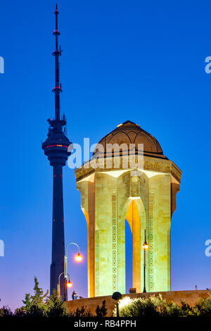 Baku Tv Tower and Eternal flame memorial in Martyrs' Lane, Baku, Azerbaijan - Stock Photo