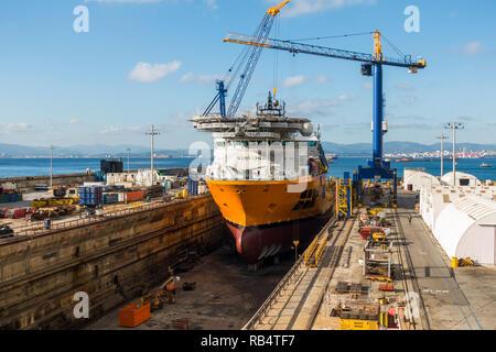 Dry dock. SBM installer Vessel, support vessel being repaired in dry dock, British overseas territory of Gibraltar. - Stock Photo