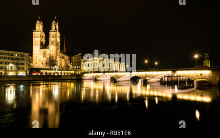 Zurich, ZH / Switzerland - 4 January 2019: the Grossmuenster cathedral and bridge at night in downtown Zurich in Switzerland - Stock Photo