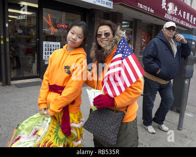 Young Lion dancer and her mom in the Bensonhurst section of Brooklyn on Chinese New Year, 2017. - Stock Photo