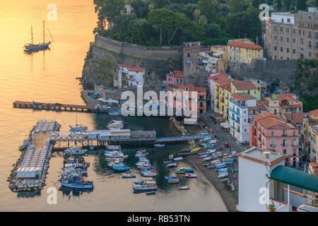 Early morning looking over the Marina Grande in Sorrento and the Bay of Naples in Italy - Stock Photo