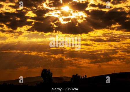 The sun shining through low cloud - Stock Photo