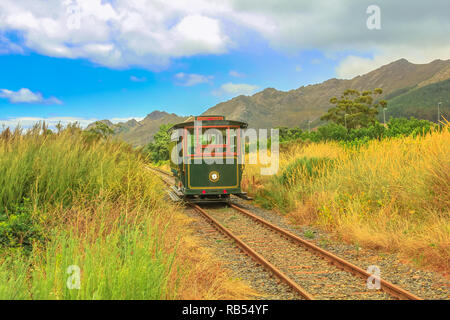 Franschhoek Wine Tram hop-on hop-off tour, one of the best ways to discover Franschhoek Valley in scenic landscape of Wine Region, near Cape Town, South Africa. - Stock Photo