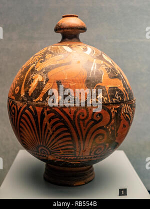 Italy Basilicata Melfi Castle National archeologic museum- Red-figure globular pisside. On the lid, seated hermaphrodite erot, with patera in hand, which holds a fawn and menade with chiton and chlamydia. IV sec a.C.  tomb, tomba,necropoli Valleverde - Stock Photo