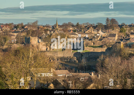 The ruins of the castle and part of the town of Barnard Castle, Teesdale, County Durham, UK  in winter sunshine - Stock Photo