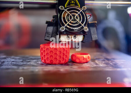 3D printer printing, also known as additive manufacturing (AM), refers to processes used to create a three-dimensional object in which layers of mater - Stock Photo