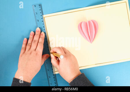 DIY Valentines greeting card blue wooden background. Gift ideas day love, February 14, Valentines Day. Handmade. Card volumetric heart paper form ball - Stock Photo